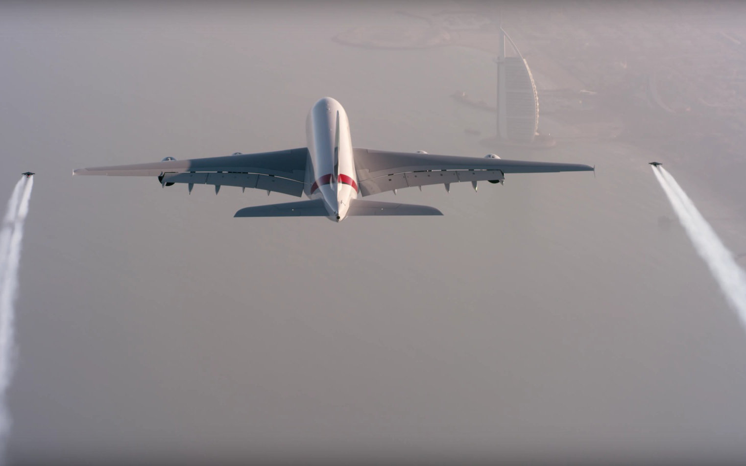 Watch Two Jetpackers Fly Next to an Emirates Airplane 4,000 Feet in the Air