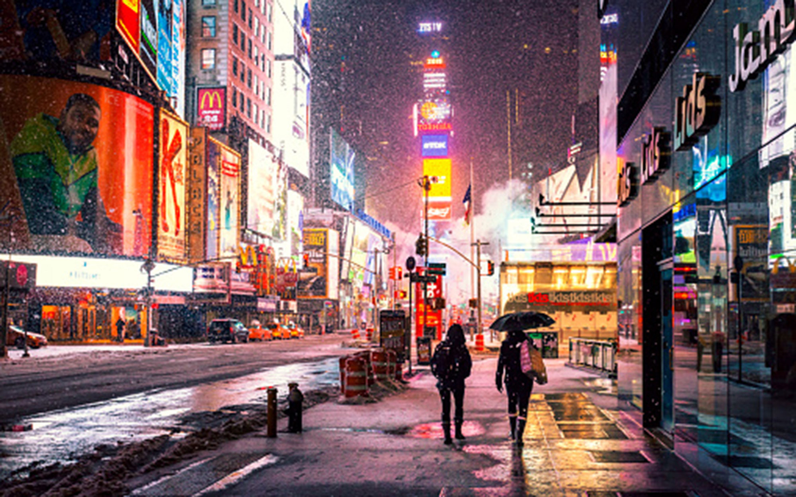 Times Square at night in New York City, NY