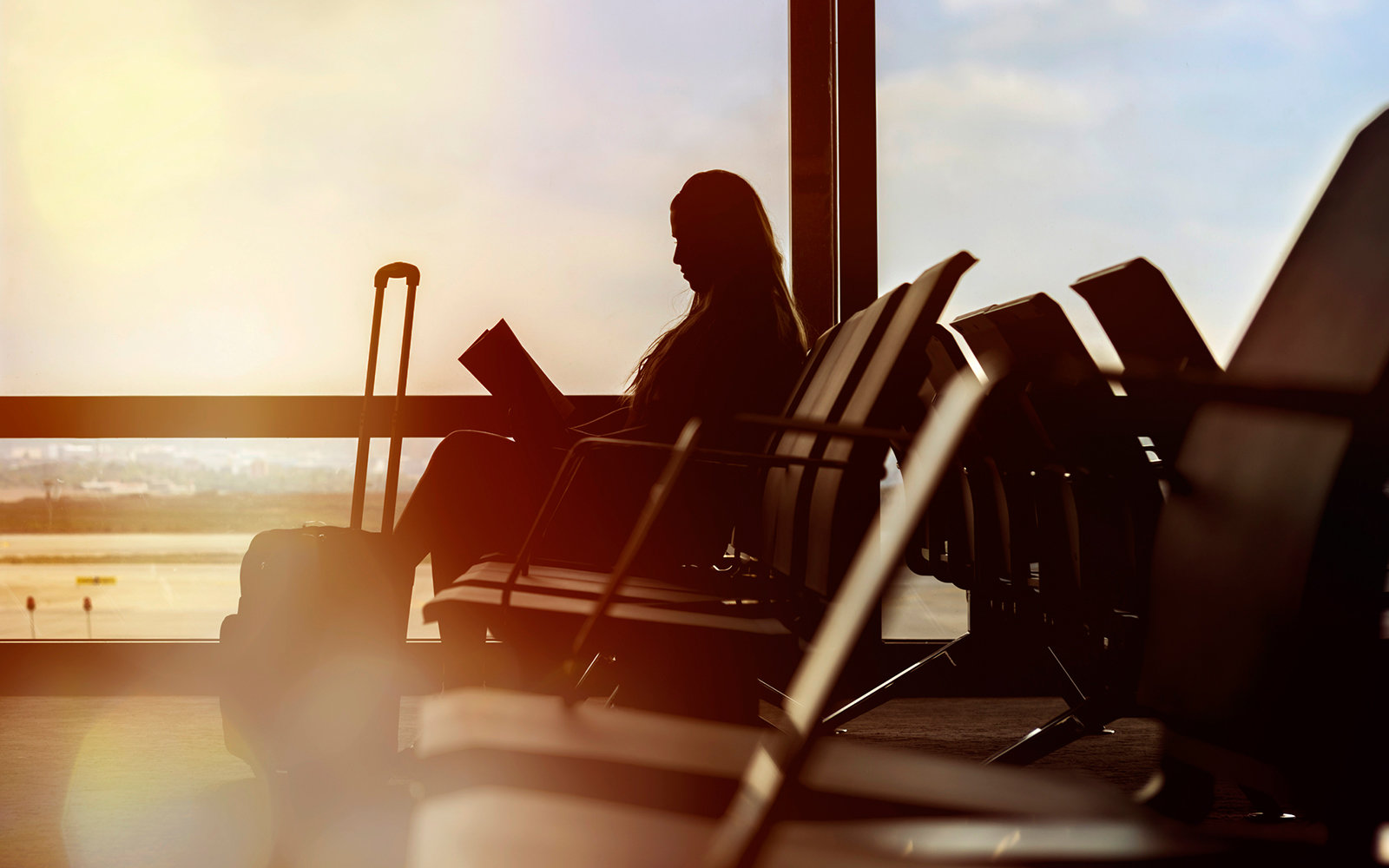 side view of woman waiting in airport