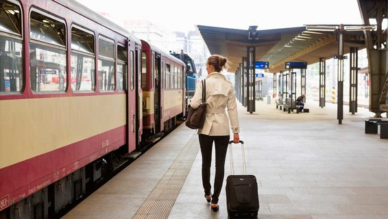 Woman Traveling on Train in Europe