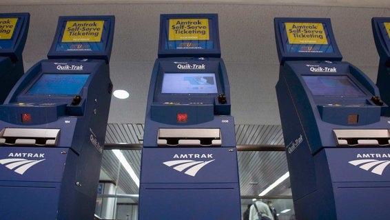 Automated ticketing booths stand at the Amtrak sales area at