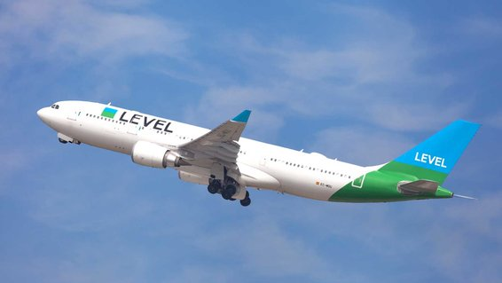 Level Airbus A330-200 taking off from El Prat Airport in Barcelona, Spain.