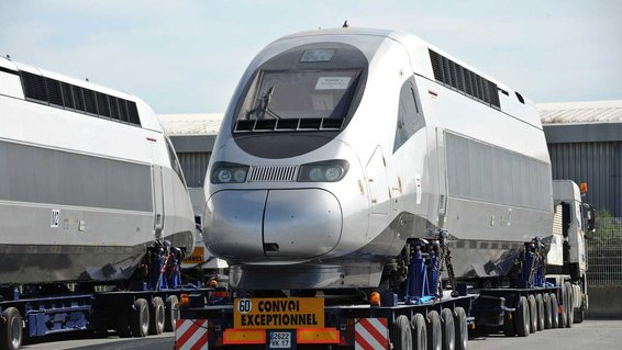 A carriage of a high speed train TGV produced by Alstom is loaded on a ship leaving for Tanger, at La Rochelle's harbour on June 26, 2015.