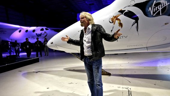 Sir Richard Branson walks around the new Virgin Galactic SpaceShipTwo
