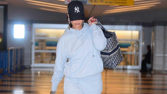 Rihanna Pairs Manolo Blahnik Heels With A Grey Sweatsuit As She Jets Into NYC For Her Pop Up Shop Opening