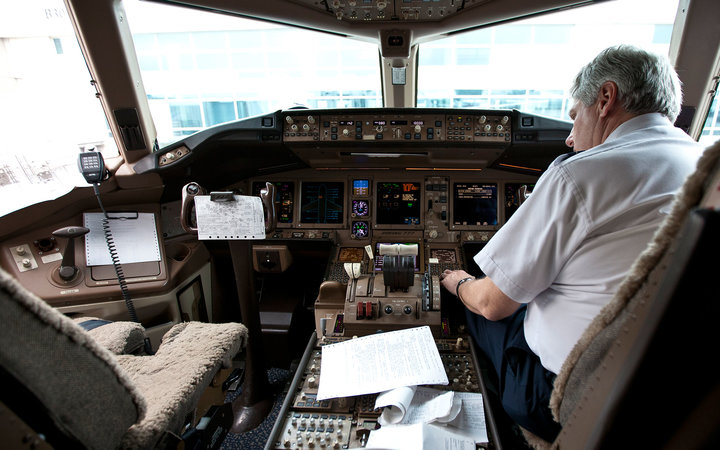 VAIL, UNITED STATES - FEBRUARY 05: Pilot in the cockpit of a Boeing 777 at Denver International Airport on February 05, 2011 in Vail, Colorado, United States.  (Photo by EyesWideOpen/Getty Images)
