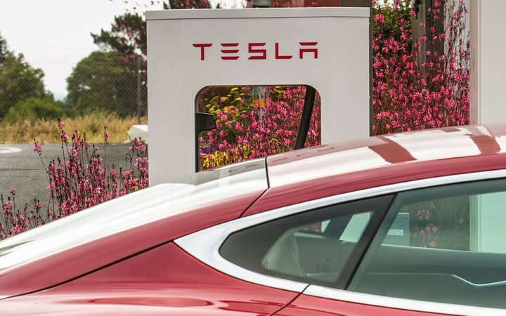 BUELLTON, CA - JULY 13:  A Tesla electric car stops at a recharging station at the Marriott Hotel near Highway 101 on July 13, 2014, in Buellton, California. Because of its close proximity to Southern California and Los Angeles population centers, the San
