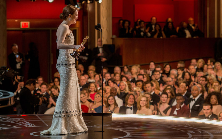 HOLLYWOOD, CA - FEBRUARY 22:  Actress Julianne Moore, winner of the Best Actress in a Leading Role Award for 'Still Alice', appears onstage at the 87th Annual Academy Awards at Dolby Theatre on February 22, 2015 in Hollywood, California.  (Photo by Christ
