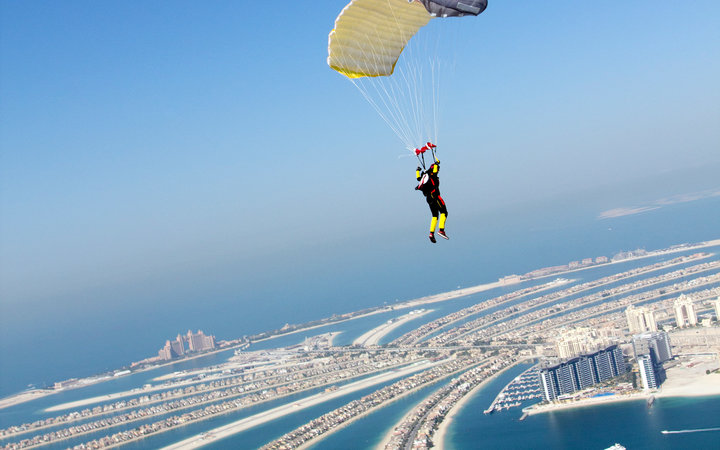 Jumper under canopy flying over the Dubai Palm