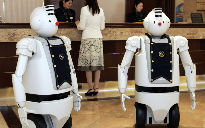 URAYASU, JAPAN:  Hitachi's humanoid robots  EMIEW  greet guests at the front desk of the Sheraton Grande Tokyo Bay hotel in Urayasu, suburban Tokyo, 06 March 2006. The Sheratan and Hitachi have collaborated for a week-long promotion for their guests at th