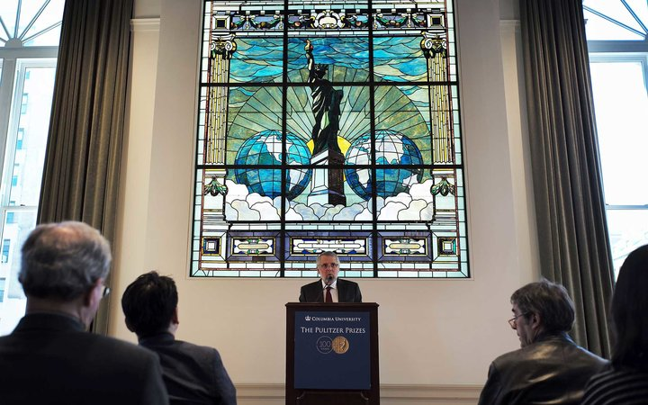 Mike Pride, administrator of The Pulitzer Prizes, announces the 2016 Pulitzer Prize winners at the Columbia University in New York on April 18, 2016.  / AFP / Jewel SAMAD        (Photo credit should read JEWEL SAMAD/AFP/Getty Images)
