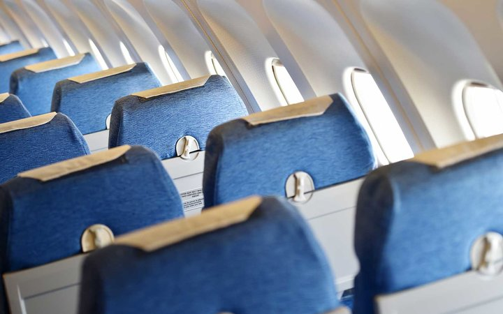 Blue airplane empty seats with new head rest covers