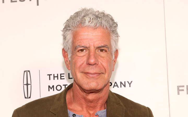 Bourdain posts first photo with new girlfriend.