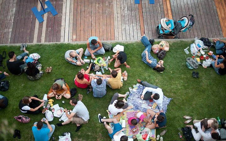 People eat on the banks on the Seine river on the opening day of  Paris-plage  event on July 20, 2010 in Paris. For the nineth summer, Paris transforms the banks of the Seine into full-fledged beaches with palm trees, outdoor showers and hammocks. The eve