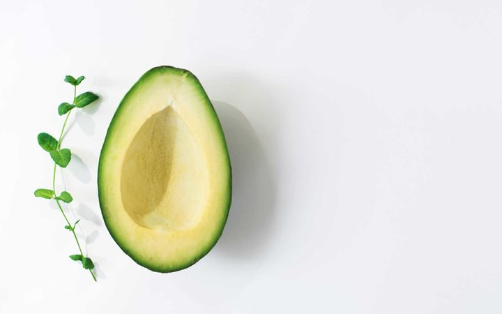 Fresh split Avocado with copy space on white background