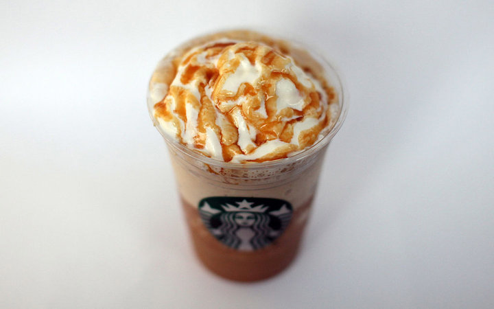 A Starbucks Corp., ''Frappuccino'' iced coffee is arranged for a photograph in London, U.K., on Thursday, Dec, 1, 2011. Starbucks Corp., the world's largest coffee-shop operator, plans to add 200 more drive-through stores across the U.K. in an expansion t