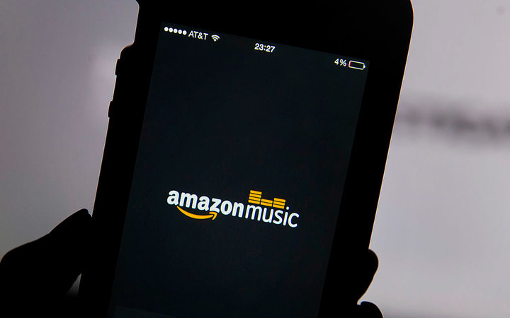 The Amazon.com Inc. Prime Music logo is displayed on an Apple Inc. iPhone 5 for a photograph in San Francisco, California, U.S., on Thursday, June 12, 2014. Amazon.com Inc. introduced advertising-free music streaming with more than a million songs, rampin
