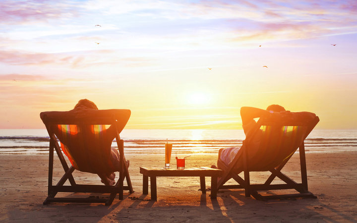 happy couple enjoy luxury sunset on the beach during summer vacations