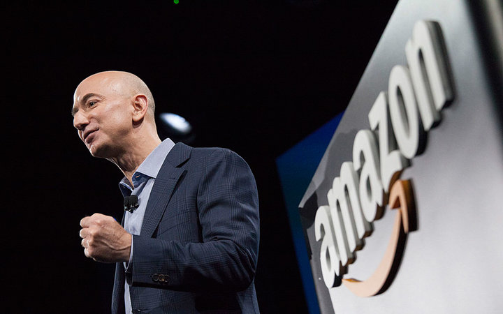 SEATTLE, WA - JUNE 18: Amazon.com founder and CEO Jeff Bezos presents the company's first smartphone, the Fire Phone, on June 18, 2014 in Seattle, Washington. The much-anticipated device is available for pre-order today and is available exclusively with A