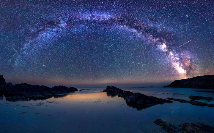 Long time exposure night landscape with Milky Way Galaxy during the Perseids flow above the Black sea, Bulgaria