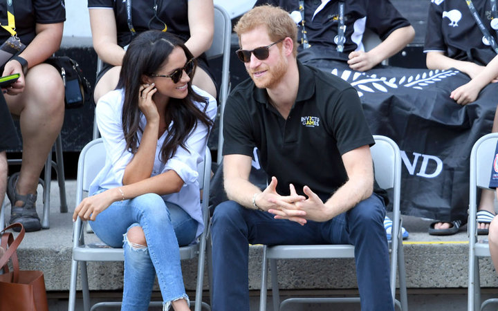 Meghan Markle and Prince Harry watching the Invictus Games