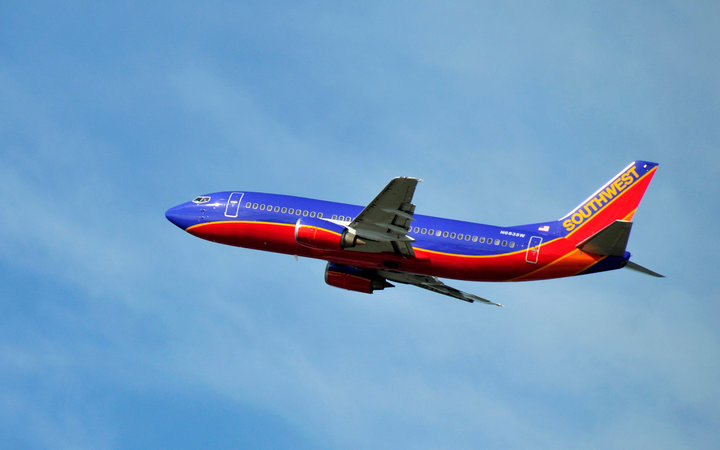 Southwest airlines plane flying through air