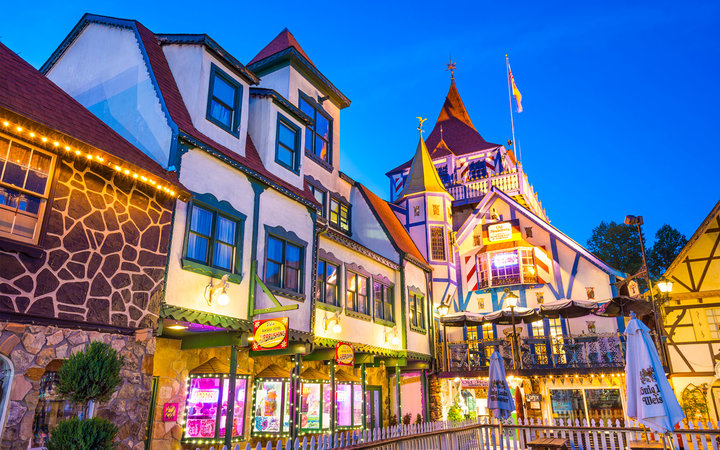 Helen, Georgia, USA - May 7, 2013: Helen Square illuminated at twilight. The architectural theme of the city is inspired by the Bavarian Alps and is a popular Oktoberfest destination.