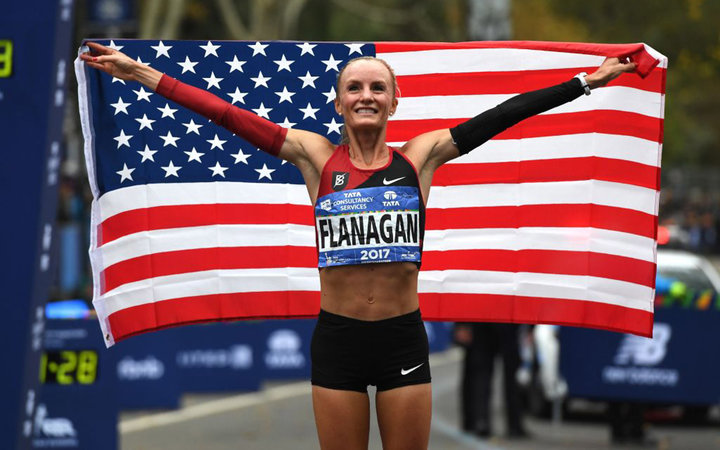 Shalane Flanagan of the US celebrates after she won the Women's  Division during the 2017 TCS New York City Marathon in New York on November 5, 2017.