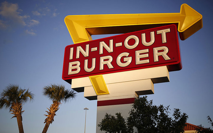 Signage is displayed outside an In-N-Out Burger restaurant in Fort Worth, Texas