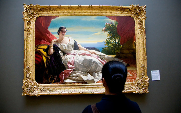 Visitor looking at portrait of Princess Leonilla by Franz Xaver Winterhalter at Getty Museum.