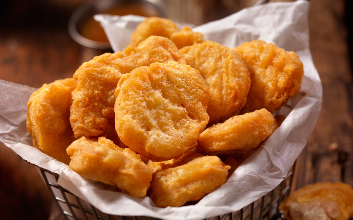 Basket of Chicken Nuggets with Sweet and Sour Sauce