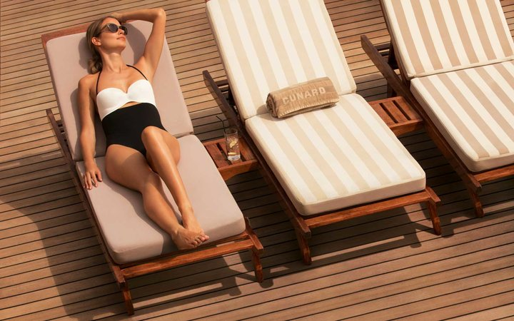 Sunbathing on the deck of the Queen Mary 2