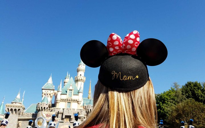 Mom in Minnie Mouse ears at Disneyland in California