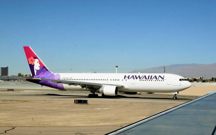 A Hawaiian Airlines jet taxies out