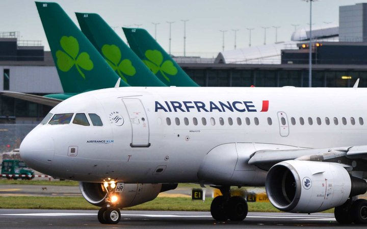 An Air France plane is about to take off on the runway at Dublin airport.