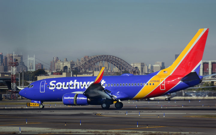 A Southwest Airlines passenger jet (Boeing 737) lands at LaGuardia Airport in New York, New York