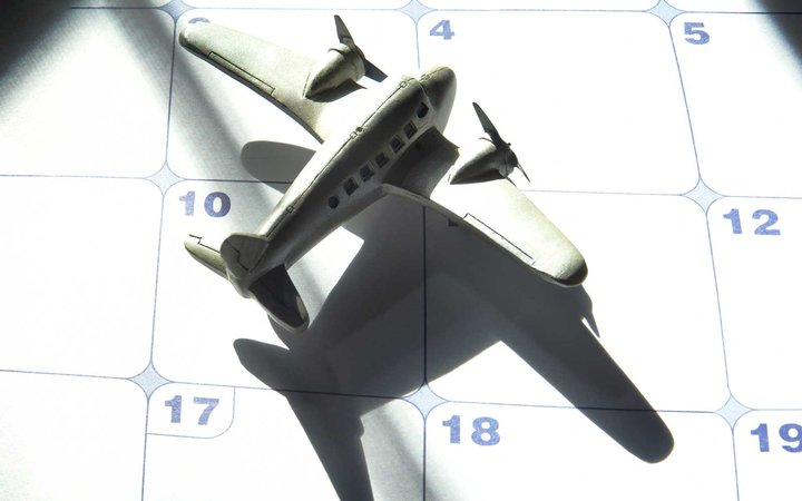 Toy plane with dramatic shadow on a calendar