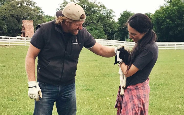 Chip and Joanna Gaines with a baby goat
