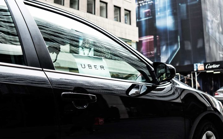 Uber car with sign in the window