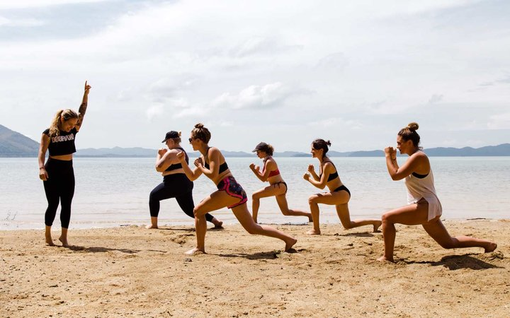 Beach bootcamp session on a Free People Escapes trip to Thailand