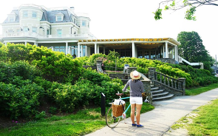 Woman with a bike at The Chanler at Cliff Walk
