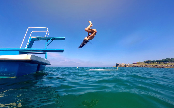 Jumping into body of water