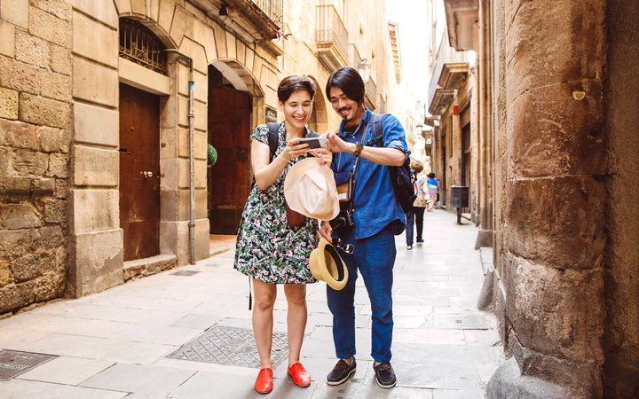 People using smartphone on Barcelona street, Spain