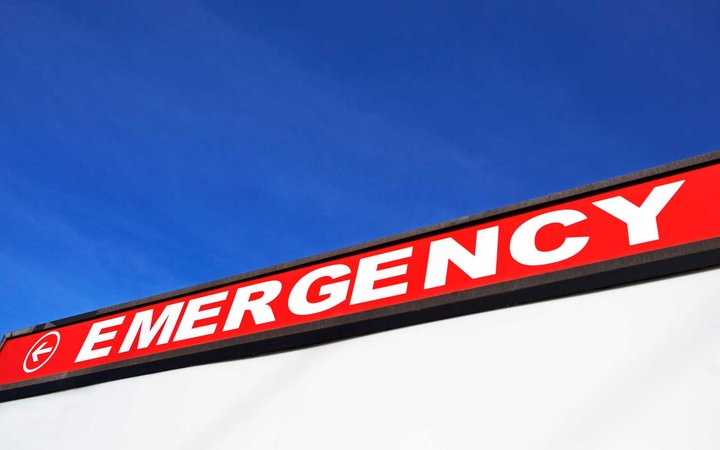 Sign pointing to emergency care