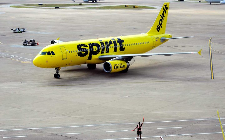 A Spirit Airlines Airbus A320 passenger jet taxis at the Dallas/Fort Worth International Airport