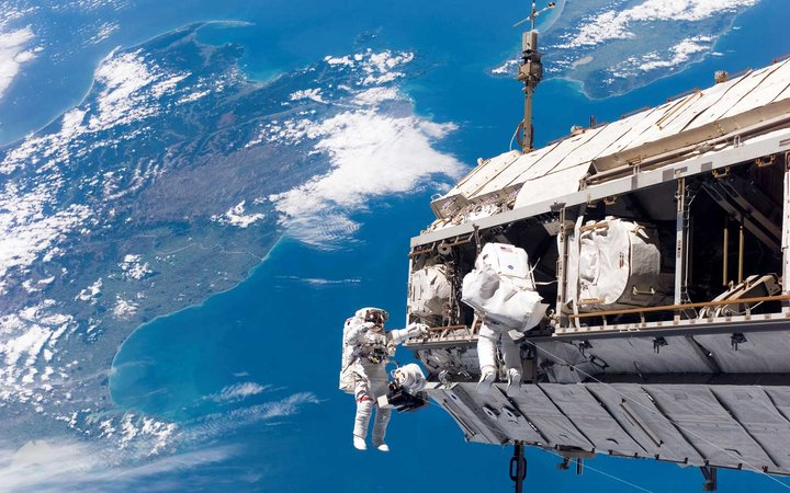 STS-116 Mission Specialists Robert L. Curbeam, Jr. (left) and Christer Fuglesang participate in the first of the mission's three planned sessions of extravehicular activity as construction resumes on the International Space Station.