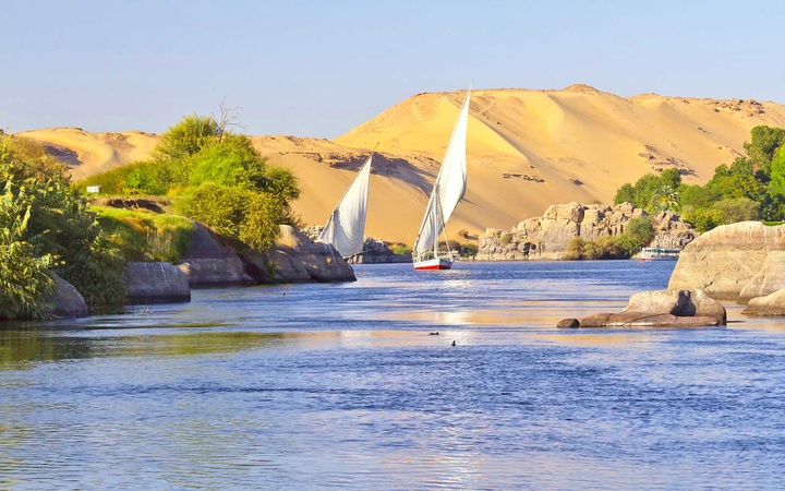 Sailing boats on Nile river near Aswan, Egypt