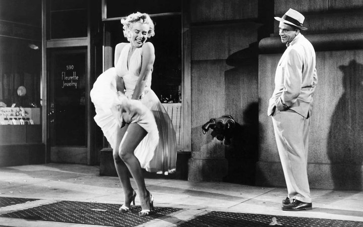 Actress Marilyn Monroe and actor Tom Ewell on the set of The Seven Year Itch.