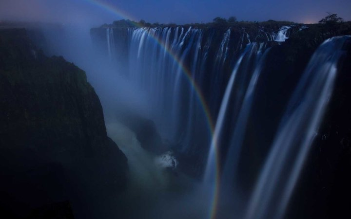 Double lunar rainbow, photographed at night at Victoria Falls, Livingstone, Zambia
