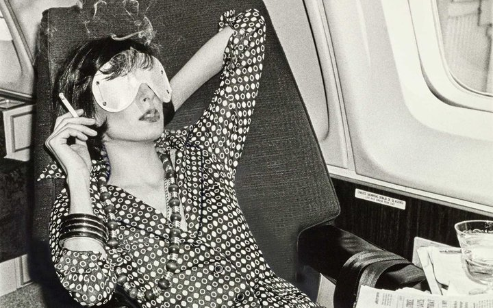 Woman Relaxing on Airplane